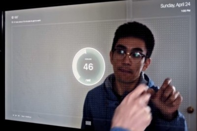 A guy invented smart mirror with touchscreen to interact